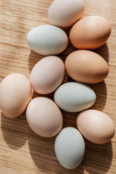10 eggs on wooden board